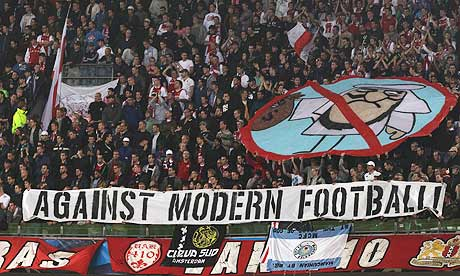 Ajax fans show the banner at the Manchester City game that has led to a €10,000 fine from Uefa