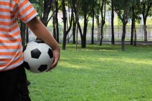 boy-holding-a-ball